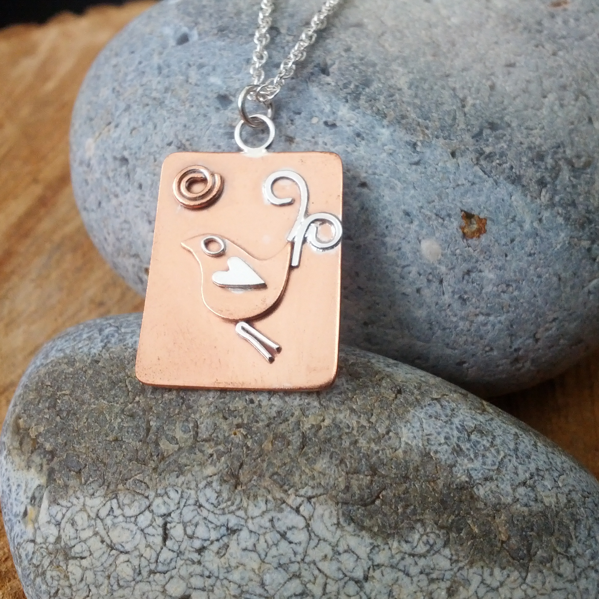 Copper bird and sun pendant