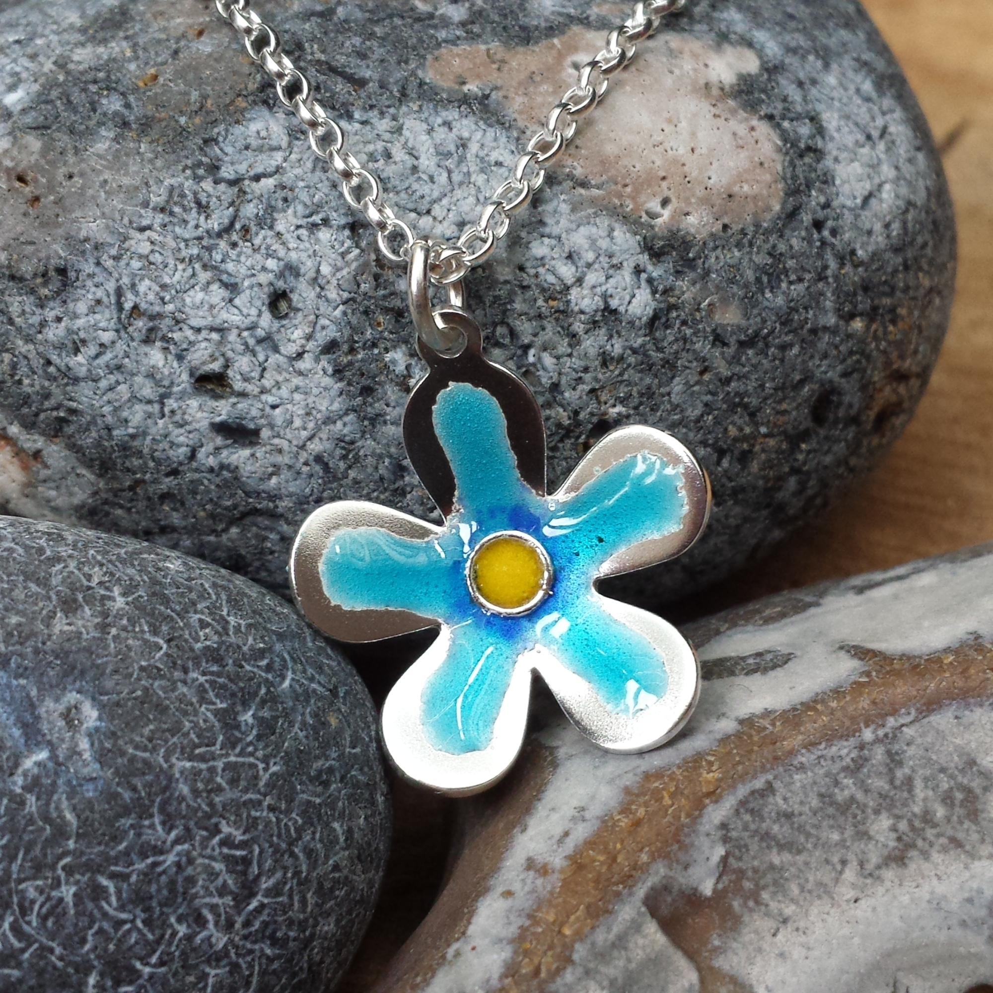 Silver and enamel flower pendant