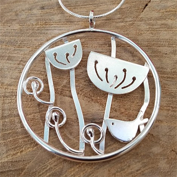 Silver bird and meadow pendant