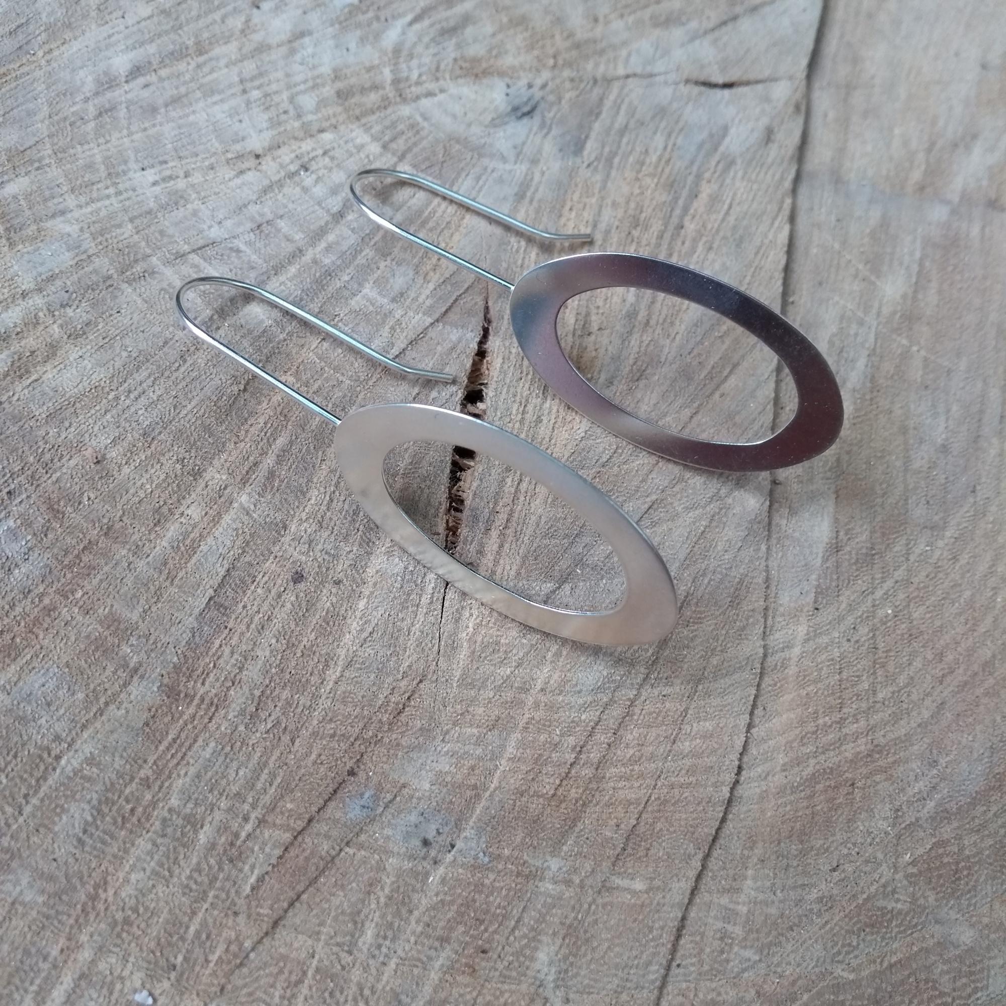 Silver oval dangle earrings