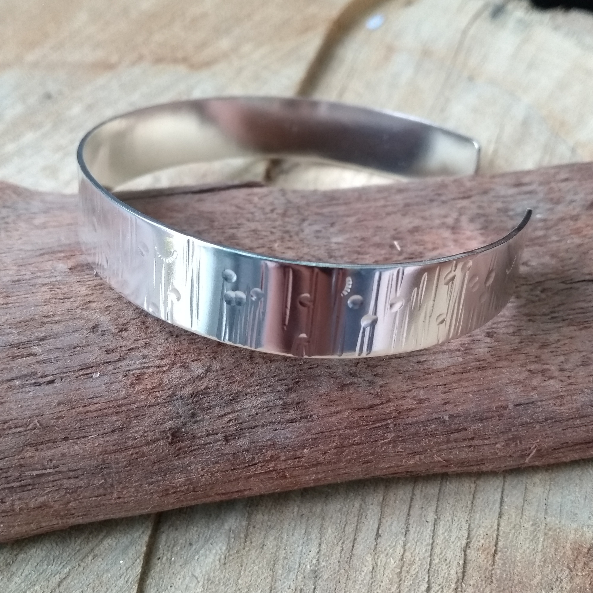 Silver bangle with meadow texture