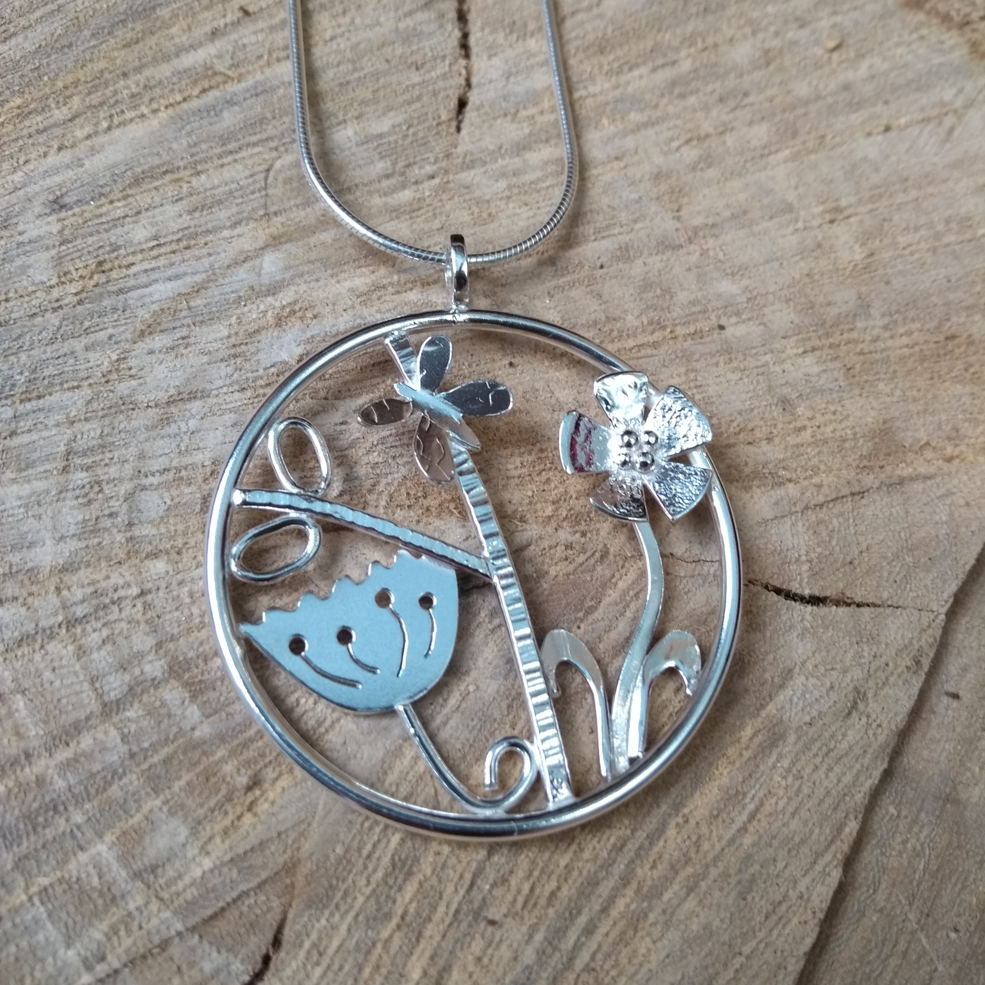 Silver butterfly and meadow pendant