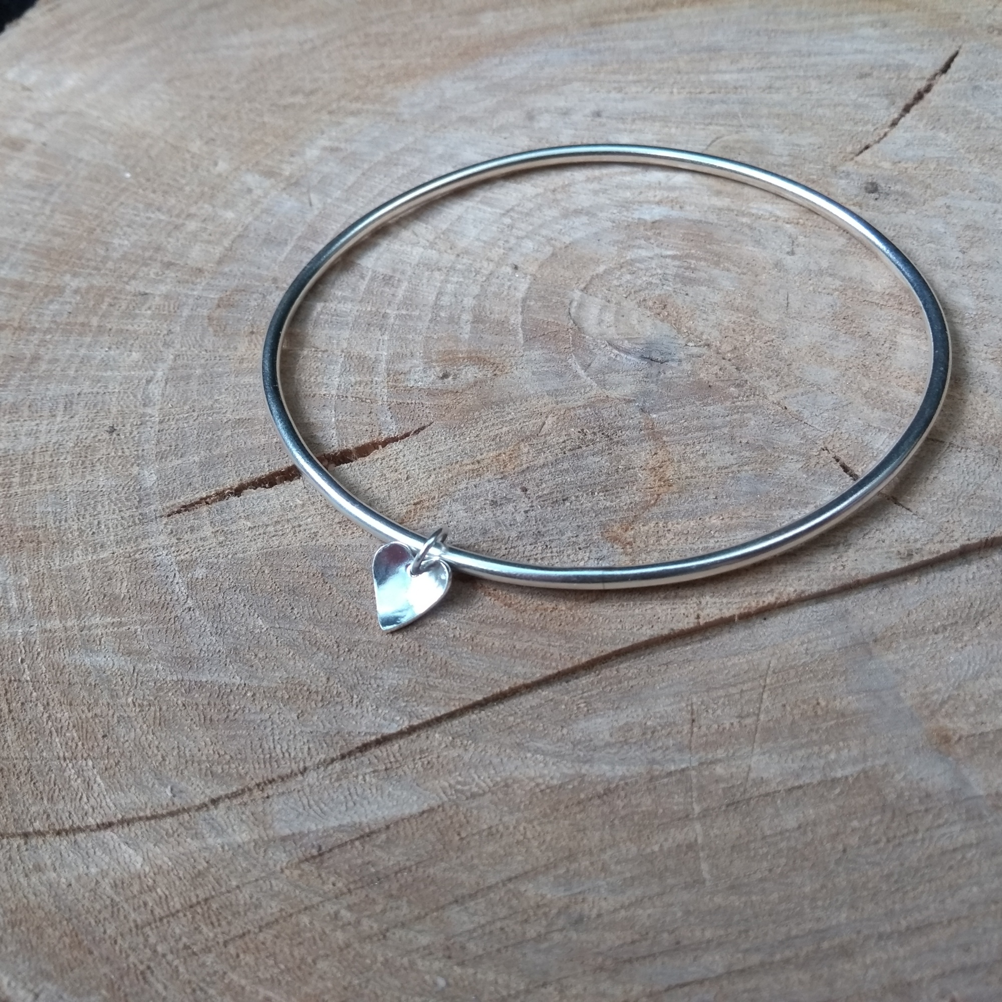 Silver bangle with heart dangle