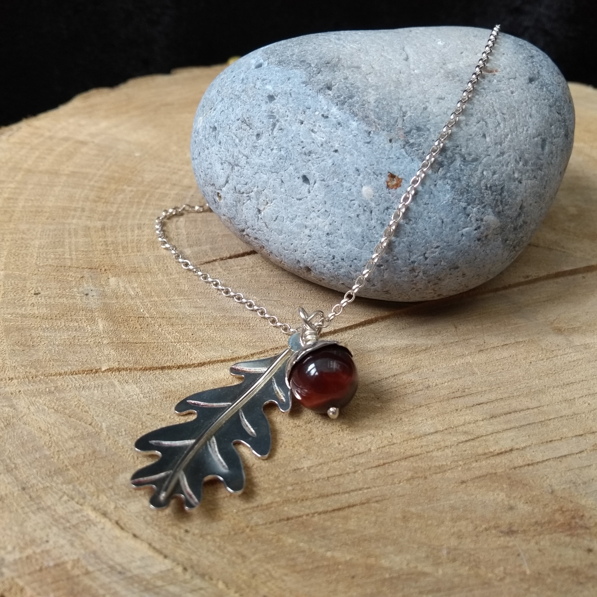 Silver acorn and oak leaf pendant with red tigers eye stone