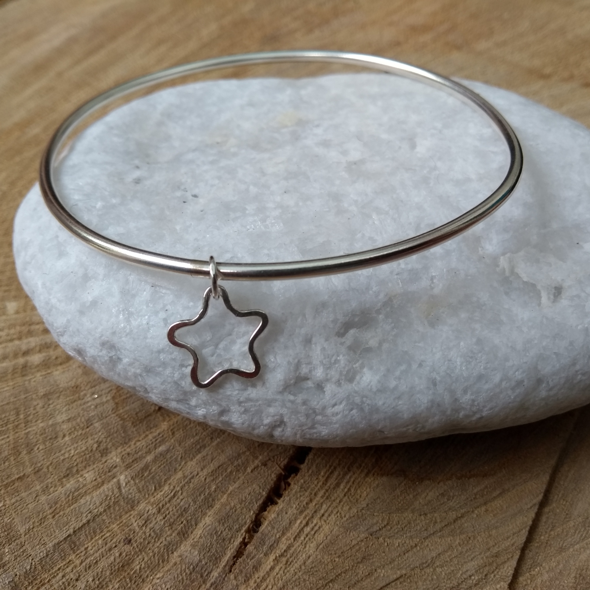 Silver bangle with star shaped dangle