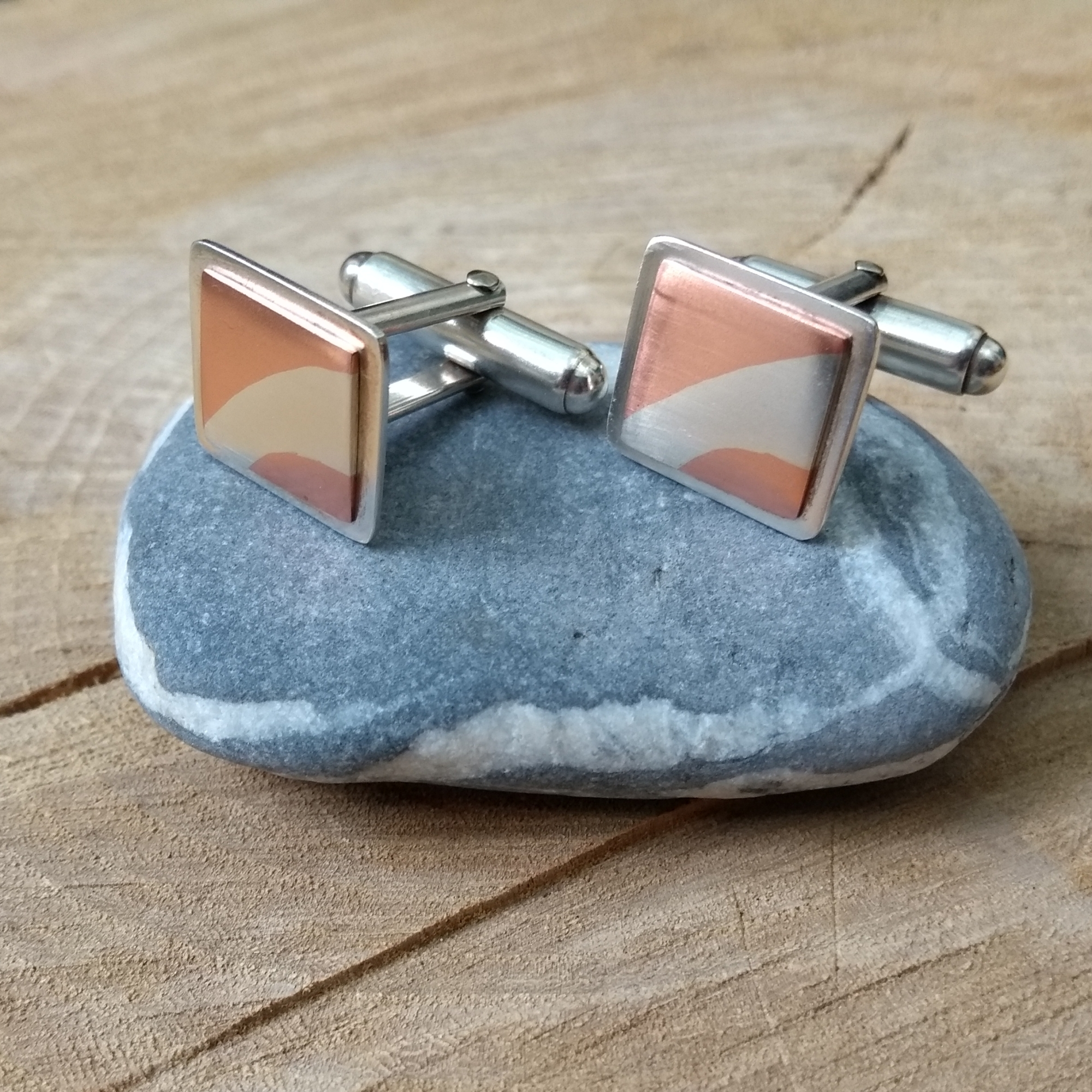 Silver and copper cufflinks